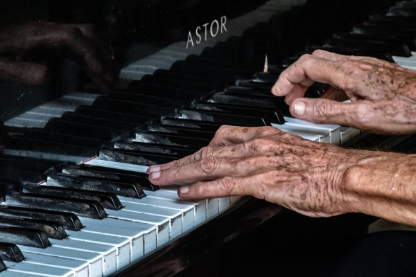 Photos of elderly hands playing the piano
