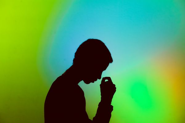 Silhouette of man against a colourful backdrop