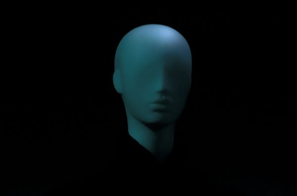 Photo of a mannequin's head against a dark background