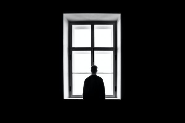 Photo of man at a window